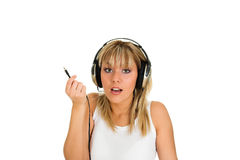 Unplugged. Young blond girl with unplugged headphones Stock Images