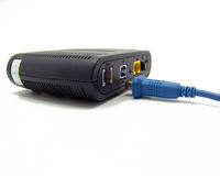 Unplugged adsl modem. Black adsl modem with unplugged blue lan cable Royalty Free Stock Photo