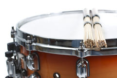 Unplugged drumsticks resting on a snare drum Stock Photos