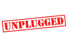UNPLUGGED. Red Rubber Stamp over a white background royalty free stock photo