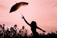 Unplugged silhouette woman with red umbrella and wanderlust Royalty Free Stock Photos