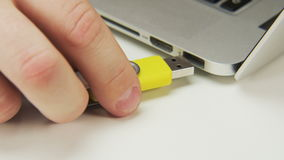 Unplugging and Plugging a Yellow Pen Drive. Cable plugging. Shot on RED Epic stock video
