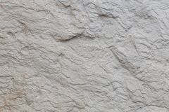 Unpolished natural stone surface. Texture, background royalty free stock photography
