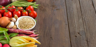 Unpolished raw rice and vegetables Stock Photography