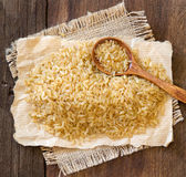 Unpolished rice with a spoon Royalty Free Stock Photo