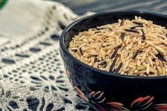 Unpolished rice on wooden background Royalty Free Stock Image