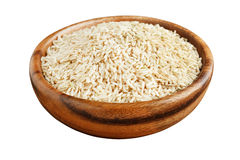 Unpolished rice in a wooden bowl Royalty Free Stock Photo