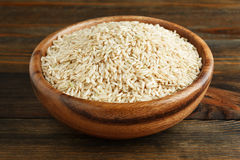 Unpolished rice in a wooden bowl Stock Images