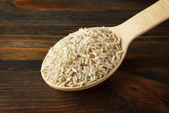 Unpolished rice in a wooden spoon Stock Photography