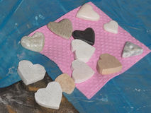 Unpolished and smoothed sandstone hearts Stock Photography