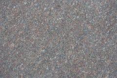 Unpolished surface of grayish pink granite stone. Unpolished surface of greyish pink granite stone Royalty Free Stock Images