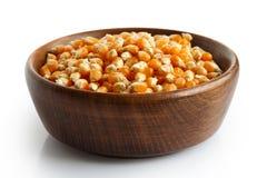 Unpopped popcorn in dark wooden bowl. Royalty Free Stock Photo