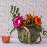 Unpretentious autumn bouquet with rowanberries. Modest autumn bouquet with rowanberries on wallpaper background rustic Stock Photos