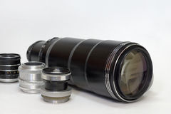 Unpretentious set different types of vintage lenses. Humble set different types of vintage lenses, nicely laid out for close-up shooting Royalty Free Stock Images