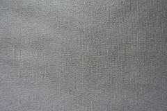 Unprinted beige jersey fabric from above. Unprinted simple  beige jersey fabric from above Royalty Free Stock Photos