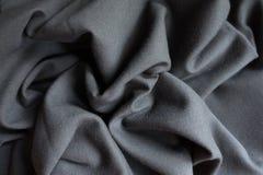 Unprinted black fabric in soft folds. Unprinted black viscose fabric in soft folds Stock Images