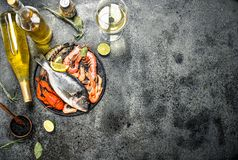 Unprocessed seafood, dorado, shrimp with white wine and spices. On a rustic background Royalty Free Stock Photos