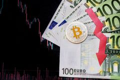 Unprofitable investment of depreciation of virtual money bitcoin. Red arrow, silver bitcoin and euro go down on paper forex chart royalty free stock image