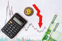 Unprofitable investment of depreciation of virtual money bitcoin. red arrow, silver bitcoin and euro banknotes go down on paper royalty free stock photo