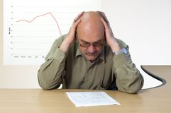 Unprofitable project. Project manager look at the financial account Royalty Free Stock Image