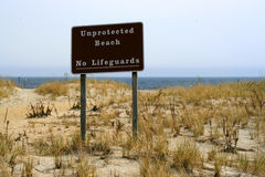 Unprotected Beach Sign - No Lifeguards Stock Photos