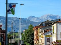 Unquera: Street and Picos de Europa mountain range at the boarder between Cantabria and Asturias stock images