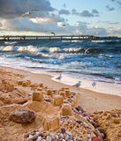 Unquiet Baltic Sea. Sand castles on the beach of Rugen island in the Baltic Sea Royalty Free Stock Photos