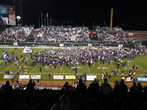 UNR Fan Cheer as players and fans celebrate field Stock Photo