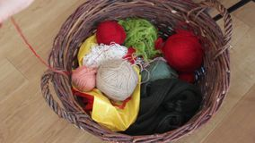 Unravel colored woolen tangles. Multi-colored tangles of thread in a basket stock video footage