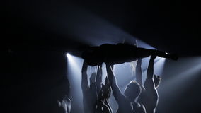 Unreal dancing on the water, in the rays of white light. A group of people dancing on the water in the rays of white light. The dance of souls in the underworld stock footage