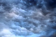 Almost unreal dark cloud formations right before a thunderstorm seen at the north sea. Almost unreal dark cloud formations right before a thunderstorm shot at royalty free stock photo