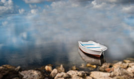 Unreal dream. Dream. Unreal. Boat and blur background of clouds and sea Stock Image