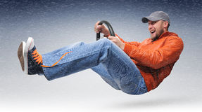 Unreal driver goes with a wheel. To a snowstorm concept Royalty Free Stock Photo