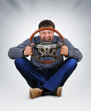 The unreal dude with a wheel in hands. On background Stock Image