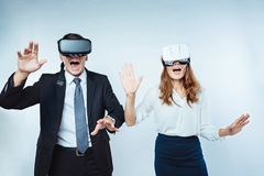 Emotional business people trying on VR headset Royalty Free Stock Images