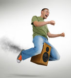 Unreal flying man sitting on a speaker. With smoke, motorcycle stylize concept Stock Images