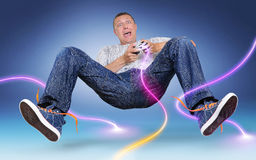 Unreal gamer with gamepad, color electric discharge. Around on blue background Royalty Free Stock Image