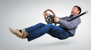 Unreal mad driver with a wheel in hands. On background Royalty Free Stock Image