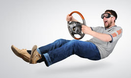The unreal mad man in goggles with a wheel in hand