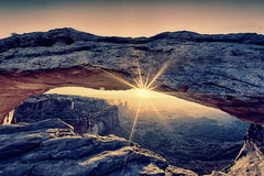 Unreal mesa arch. Sunrise at Mesa Arch iwith special photographic processing Royalty Free Stock Photo