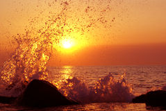 Unreal sunset splash. Morning sunset swell, sea, sun Stock Photography
