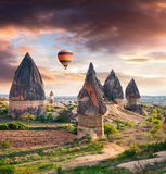 Unreal world of Cappadocia. Sunrise in Red Rose valley in April. Cavusin village located, district of Avanos in Nevsehir Province in the Cappadocia region of Royalty Free Stock Image