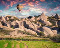 Unreal world of Cappadocia. Sunrise in Red Rose valley in April. Cavusin village located, district of Avanos in Nevsehir Province in the Cappadocia region of Royalty Free Stock Photos