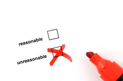 Unreasonable. Checkbox for selection on white paper with red marker pen Stock Photos