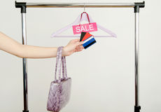 Unrecogniazible woman hand shopping with credit cards on sale. Royalty Free Stock Photography