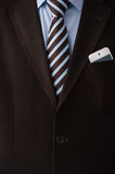 Unrecognisable confident business man wearing suit. Closeup of torso of confident business man wearing elegant suit and mobile phone at pocket Stock Photography