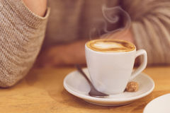 Unrecognisable man drinking coffee and having breakfast. Stock Photo