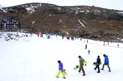 Unrecognisable people skiing on Mount Ruapehu Stock Images