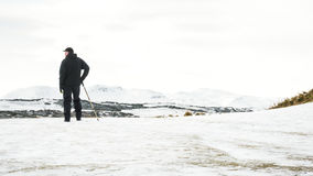 Unrecognisable senior man enjoying view , snow covered landscape, Edinburgh Stock Image