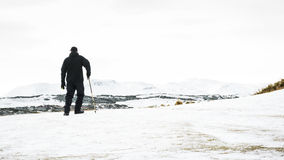 Unrecognisable senior man enjoying view , snow covered landscape, Edinburgh. Scotland Royalty Free Stock Photography